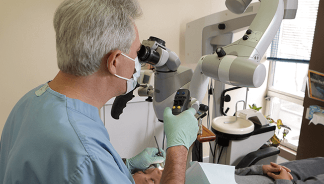 Dr Pizem with his Dental Operating Microscope